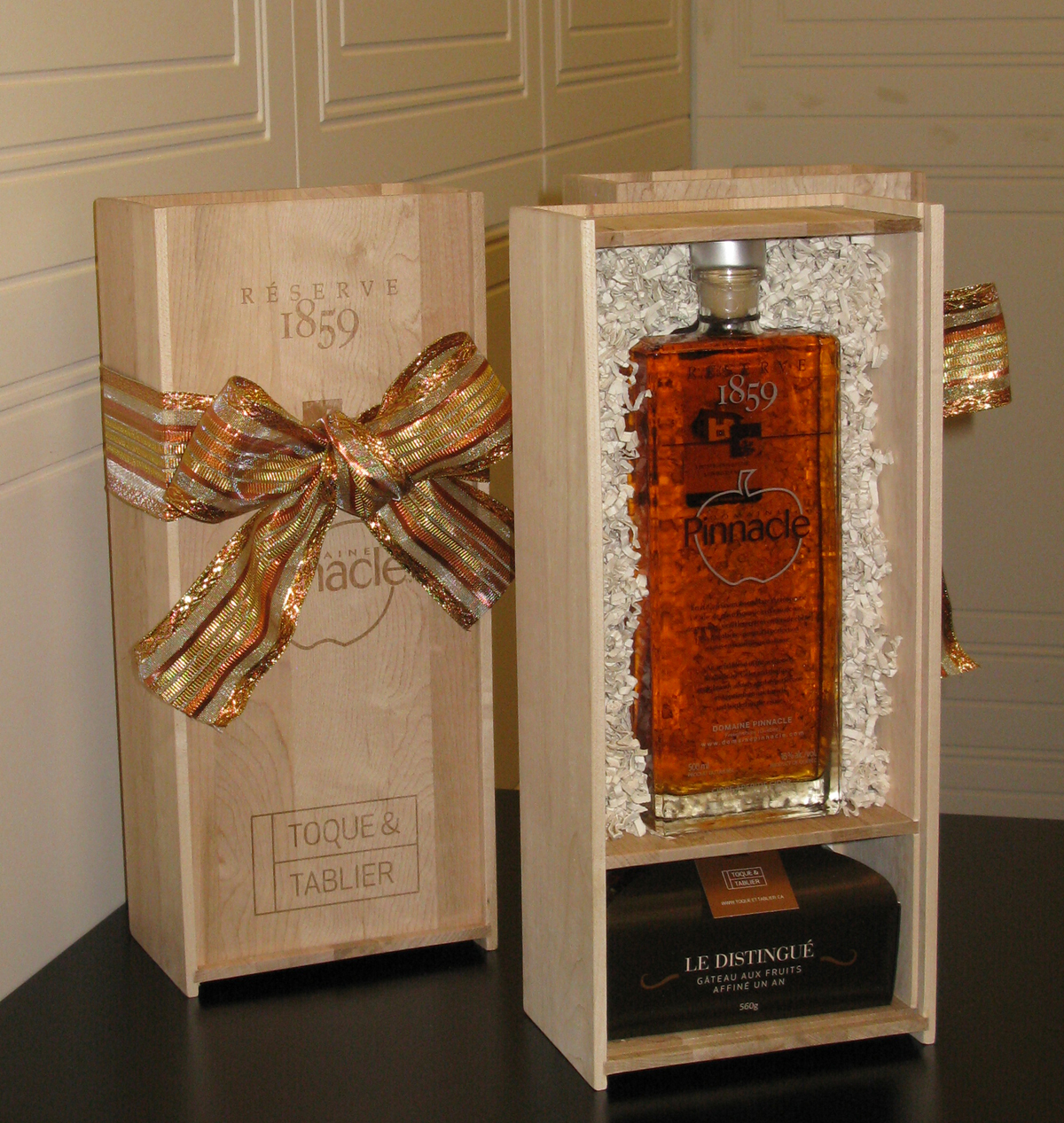 "Domaine Pinnacle Réserve 1859 ice cider-apple brandy with Toque & Tablier's limited edition fruitcake ""Le Distingué"""