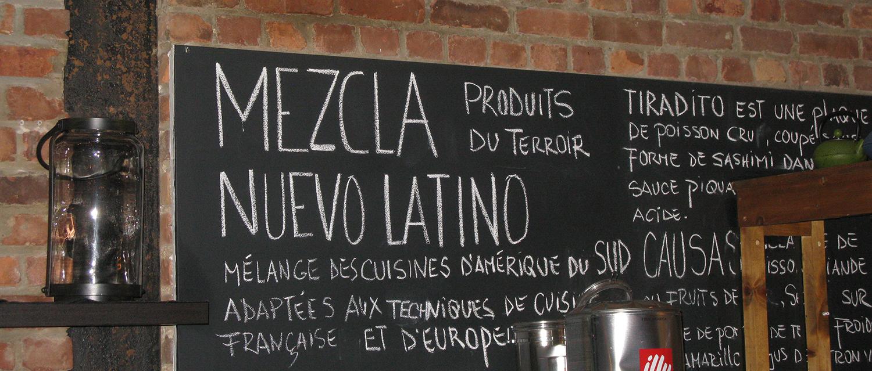 Blackboard behind open kitchen at Mezcla