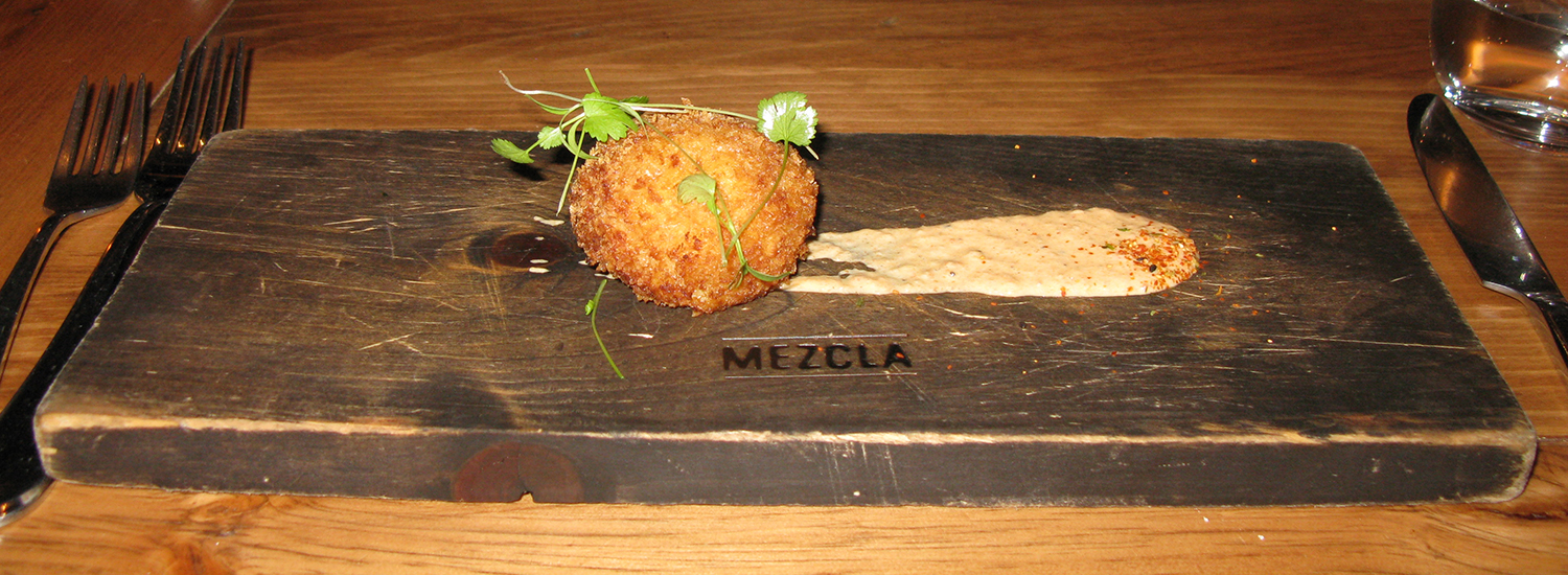 Papa rellena peruana—shrimp and garlic sprout croquette with ají amarillo reduction