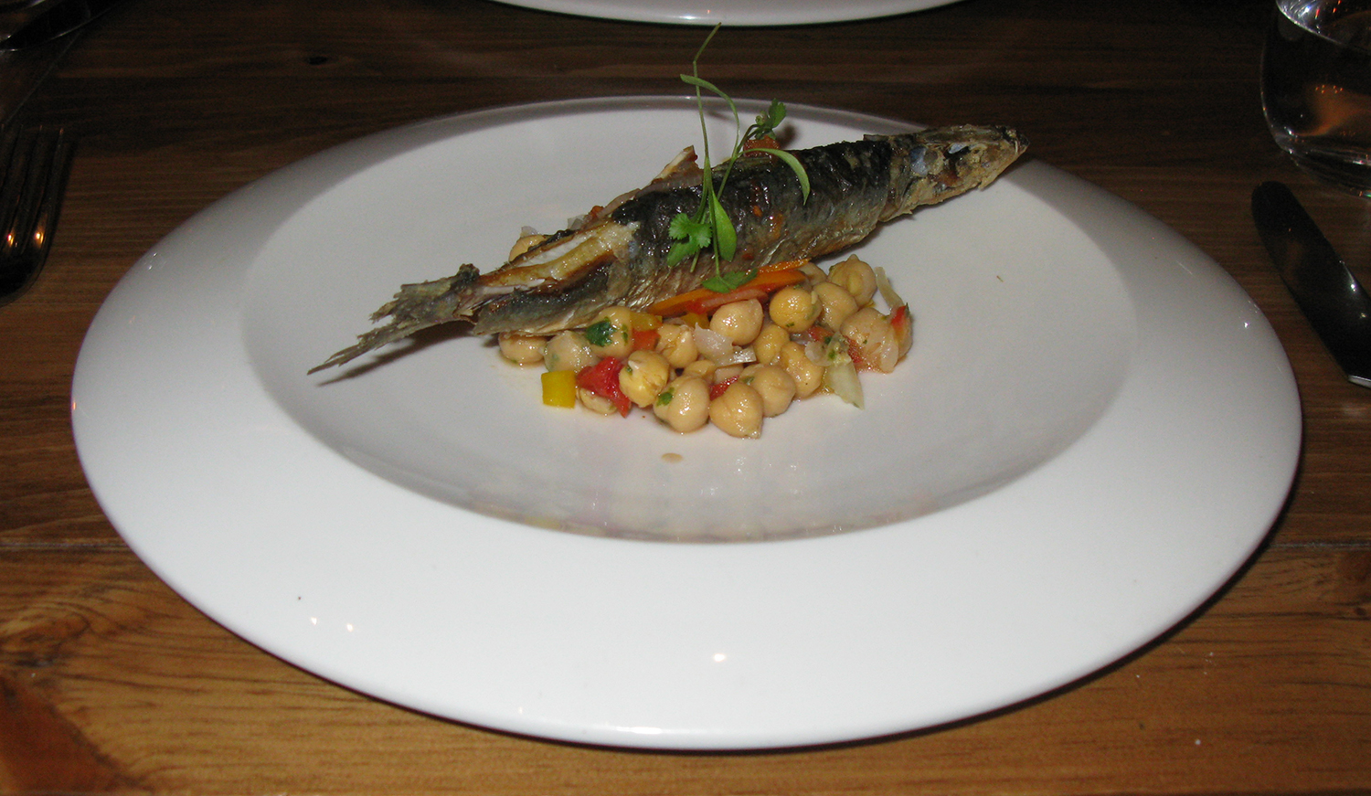 Sardinha assada—pan-seared and fried sardine with chickpea and bell pepper escabeche