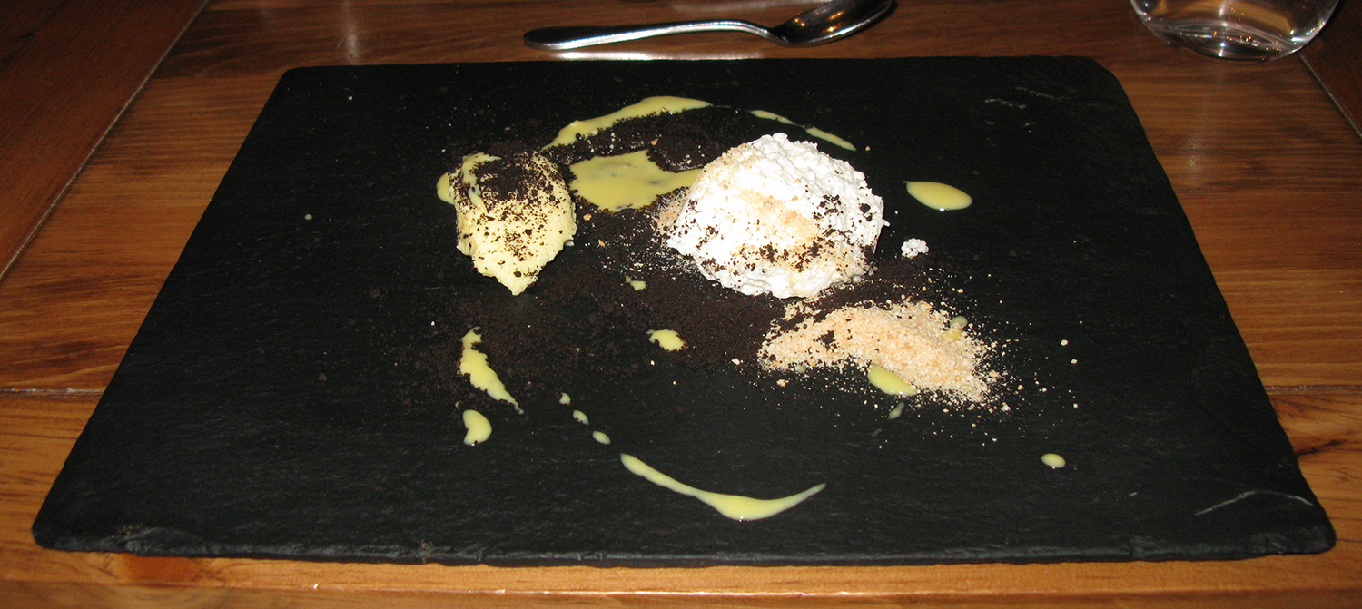 Crème brûlée and meringue mash-up, passion fruit gelatin, and crushed tea biscuits and Oreo wafers